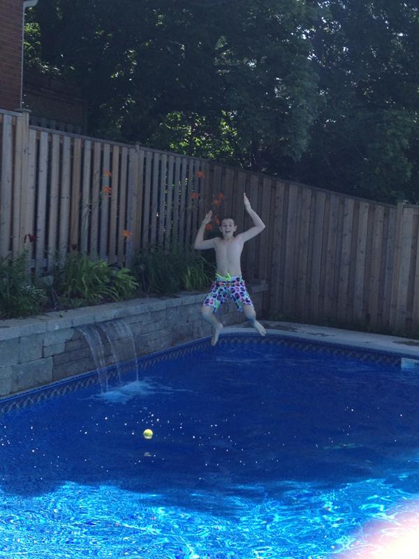 Ryan jumping in pool